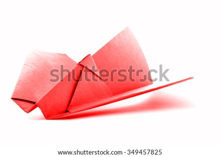 Red origami aircraft, paper plane model, isolated on white background - stock photo
