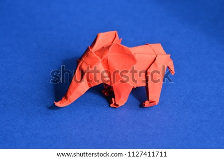 Red Origami Paper Elephant On Blue Stock Photo Royalty Free