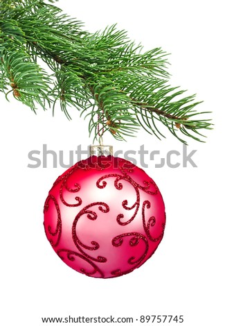 Red ornament christmas ball in a fir tree on a white background - stock photo