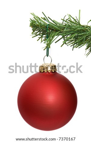 red ornament hanging on a pine tree branch