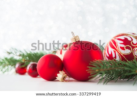 Red ornaments and xmas tree on glitter holiday background. Merry christmas card. Winter theme. Happy New Year.
