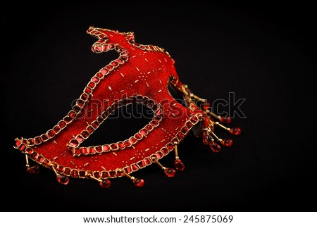 Red ornate Venice mask isolated on black - stock photo