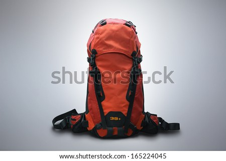 Red outdoor backpack isolated on studio background - stock photo