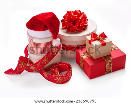 Red packs. Merry Christmas & New Year's Eve concept / studio photography of red and white box wrapping ribbon with bowknot - on white background  - stock photo