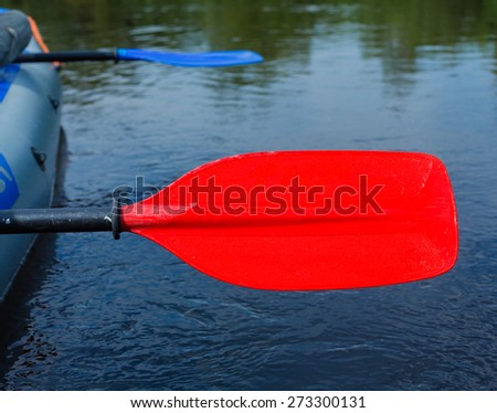 Red paddle for white water rafting and kayaking - stock photo