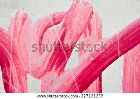 Red paint marks on a metal surface as a background image - stock photo