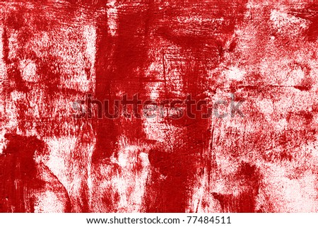 red paint on the white wall - stock photo