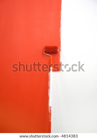 red paint roller by wall