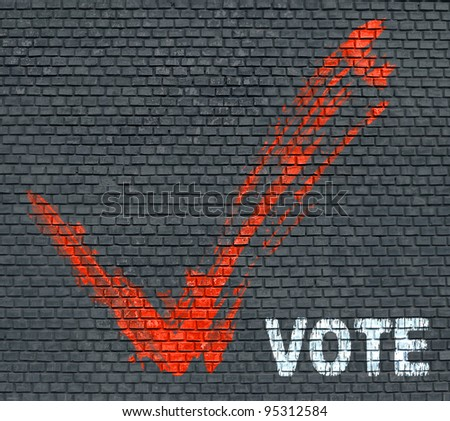 Red painted tick and word Vote on blue brick wall background - stock photo