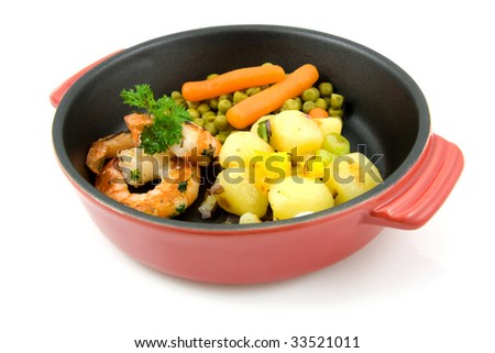 red pan with meal: potatoes, shrimp, peas and carrots, isolated on white background