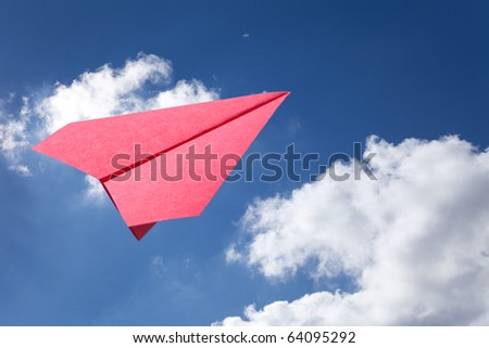 Red Paper Airplane and blue sky - stock photo