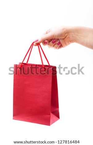 Red paper bag in female hand