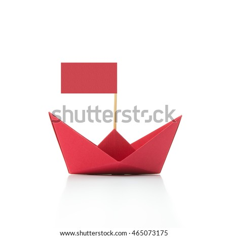 Red paper boat with plain flag on white background