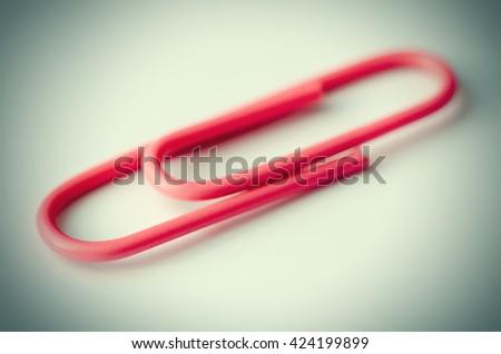 red paper clip macro closeup - stock photo