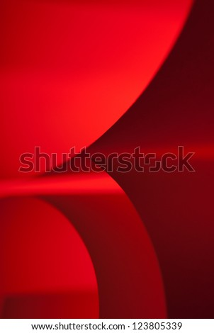 Red paper hard edge shapes abstract closeup