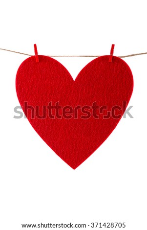 Red paper heart hanging on the clothesline - stock photo