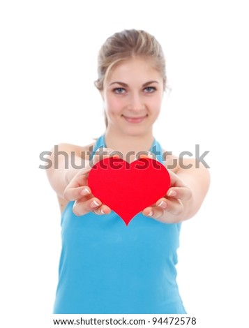 Red paper heart in a hands of a lovely girl - stock photo