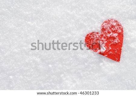 Red paper heart in the snow. - stock photo