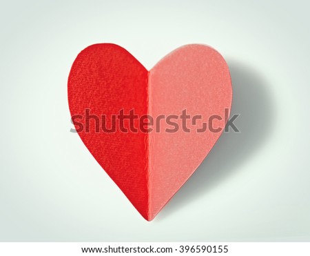 Red paper heart isolated on white background, close up