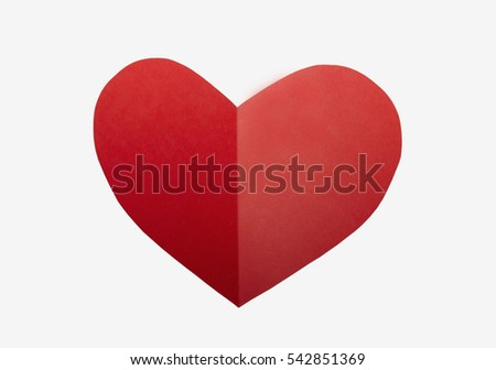 Red paper heart on white background