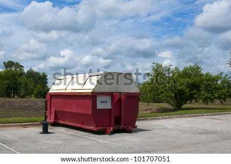 Red Paper industrial recycling dumpster marked for paper only - stock photo
