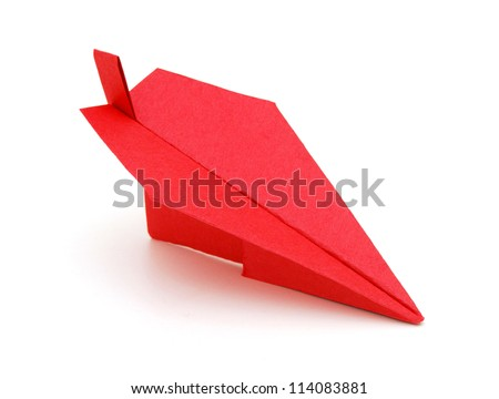 Red paper plane on white background