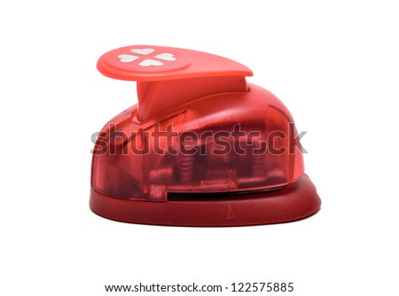 Red paper puncher on a white isolated background