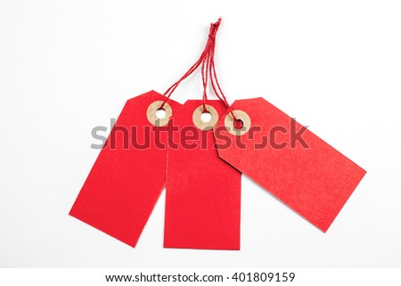 Red Paper Tags Tied with String.