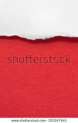 Red paper torn on a red background.