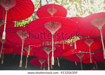red paper umbrella and wood house, Chiang Mai culture, Thailand - stock photo