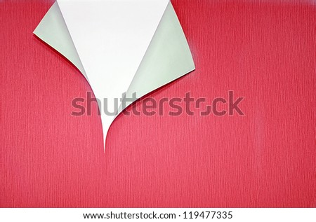 red paper with curled corner and white copyspace - stock photo