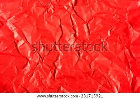 Red paper with wrinkles abstract - stock photo