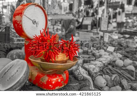 Red paprika on the vintage scales in vegetable market , black and white background. - stock photo