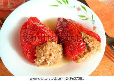 red paprika staffed with meat and rise filling - stock photo