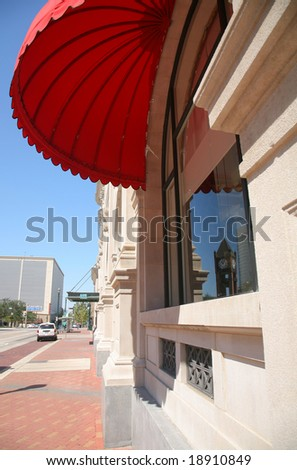 Red Parasol Shading Window with Reflection of Houston Clock Tower(Release Information: Editorial Use Only. Use of this image in advertising or for promotional purposes is prohibited.) - stock photo
