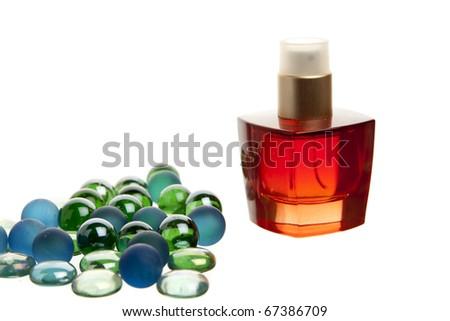 Red parfume bottle on white background back lit - stock photo