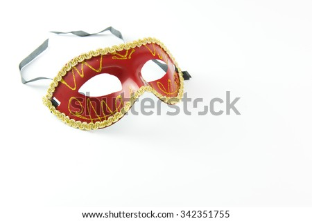 Red party masquerade mask isolated on white background