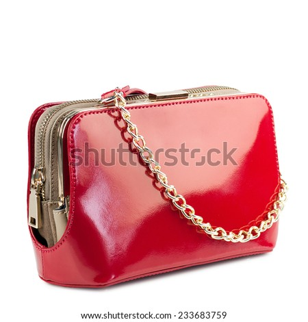 Red patent clutch isolated on white background. - stock photo