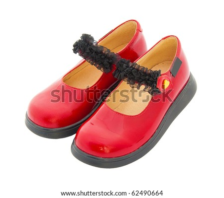 Red patent leather baby shoes with black tape. Isolated - stock photo