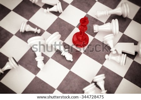 Red pawn chess wins against white pawns - stock photo