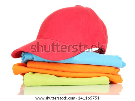 Red peaked cap with T-shirts isolated on white - stock photo