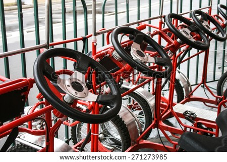 Red pedal cars - stock photo