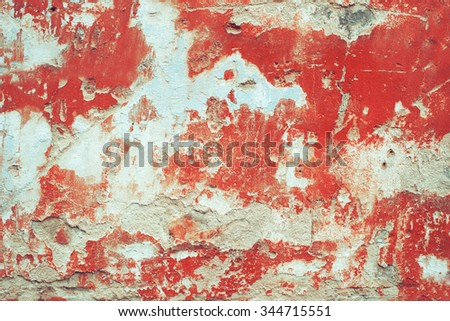 Red peeled worn damaged wall. Vintage effect.  - stock photo