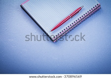 Red pen blank checked copybook office concept. - stock photo