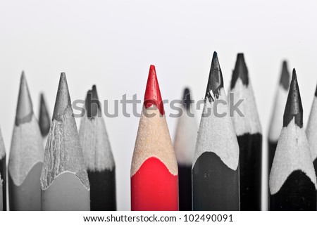 Red Pen standing out, over white background - stock photo