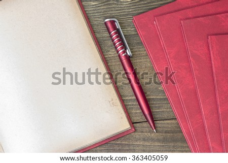 red pen with book top view