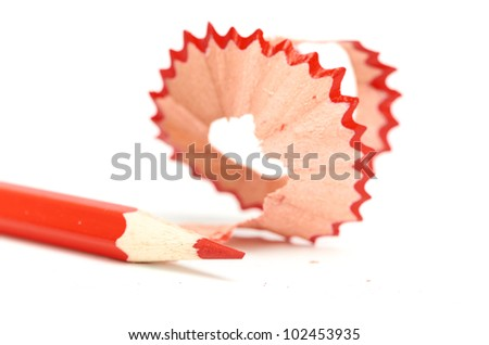 red pencil and sharpener with a shaving - stock photo