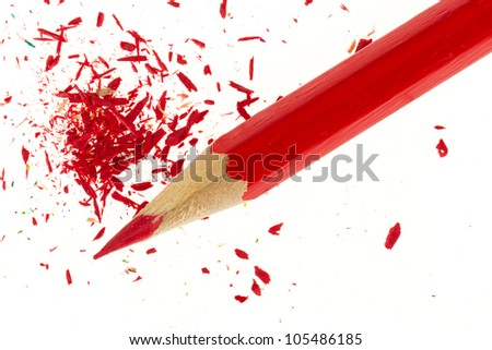 Red pencil and wood shavings isolated on white