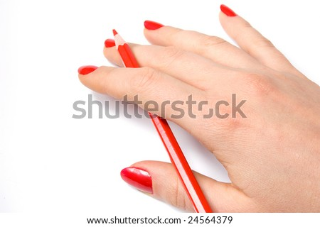 Red pencil in woman hand, isolated on white