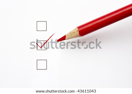 Red pencil makes a check in a check-box with soft shadow and space for copy - stock photo